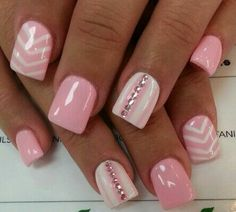 Baby pink nails with diamonds and triangular lines