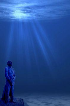 Men on fire light - Cancun Underwater Museum