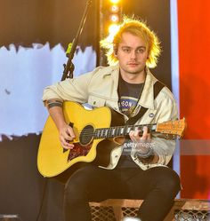 Michael Clifford of 5 Seconds of Summer performs on NBC's 'Today Show' at Rockefeller Plaza on October 28, 2015 in New York City.
