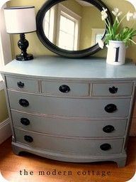 oval mirror over dresser