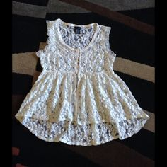 Beautiful Lace top Excellent condition. On the front, half buttons and half open. Very stylish top. On the back slightly longer then the front . Prefect for summer styles Rue 21 Tops Blouses