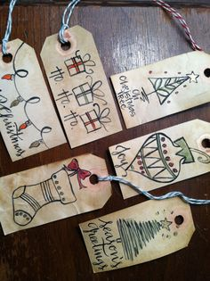 Handpainted, hand-lettered holiday gift tags. This listing is for a pack of 5, mixed tags. All tags come with red or green bakers twine for tying on packages and one blank side for writing a personalized message.