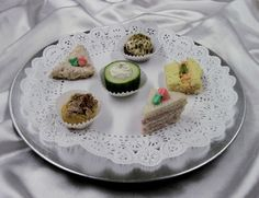 Fancy Tea sandwiches & colored cream cheese spread piped on..Pretty {from Mrs.Maddox Cakes}