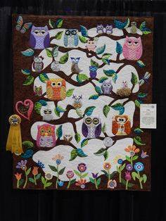 """quiltails: Another standout at Quiltfest, """"Owl Always Love You"""" by Kim Hart of Chiefland, FL. I think this may be my favorite of all the 500 quilts displayed (except for mine, of course). It's so fun and playful, with one of the best border treatments I have ever seen, great use of color and texture. Absolutely love it! Picture taken at Quiltfest Jacksonville 2014"""