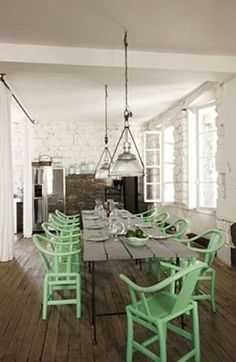 Love the green chairs with the contrast of the white walls and rustic wood floor