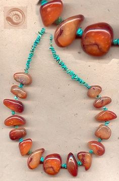 Nice use of turquoise chips. I'd substitute red coral beads instead of these more muted red ones.