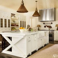 This all-white Atlanta kitchen designed by Suzanne kasler masterfully maximizes counter and storage space