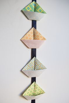 Little hands will love helping you make this pretty origami sailboat garland. Get the step-by-step tutorial, only at Babble! Diy Origami, Mobil Origami, Origami Boot, Origami Simple, Origami Fish, How To Make Origami, Origami Tutorial, Origami Paper, Origami Ideas