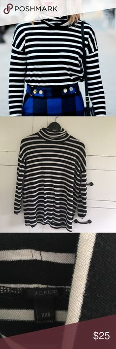 J.crew striped turtleneck Cute turtle neck in a thick knit material (I cut care tags out so I don't know for sure what it's made of) but it's a beautiful, light knit. it's been worn a few times has some pilling from washing. It's a looser fit. J. Crew Tops