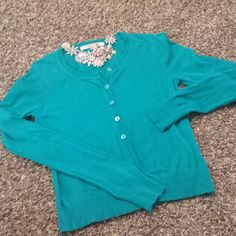 Turquoise green cardigan Super awesome color, button up cardigan.  Excellent shape with no holes rips or tears. Smoke free home. This is a small junior size medium Forever 21 Sweaters Cardigans