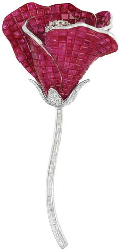 Invisibly-Set Ruby and Diamond 'En Tremblant' Flower Brooch set in white gold by Alexis.  The petals invisibly-set with square-cut rubies 45.00 cts., centering  'en tremblant' diamonds, supported with pave-set diamond leaves and diamond stem,  signed Alexis. (Doyle New York).