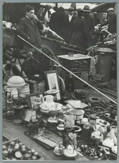 1941. Flea market at the Waterlooplein in Amsterdam. The Waterlooplein is a square in the center of Amsterdam, near the river Amstel. It was created in 1882 when the Leprozengracht and Houtgracht canals were filled in. In 1893 the square became a daily marketplace when the city government decided that the Jewish merchants in the nearby Jodenbreestraat and Sint Antoniebreestraat had to move their stalls to the Waterlooplein. Photo Spaarnestad / Wiel van der Randen. #amsterdam #1941…