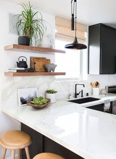 Counter top decluttering hack: Put dishes away after they've dried on the rack instead of re-using.