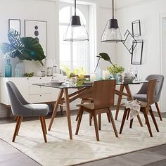 I wonder if a glass table will help your dining room seem bigger and more airy... Jensen Dining Table #westelm