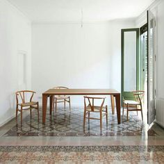 Origional floor tiles were relocated to highlight seating area, Barcelona.