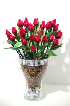 36 roses made from 72 milk chocolate Hershey Kisses. 2 Hershey Kisses are wrapped together to form a beautiful red rose. Roses are arranged in a large glass vase with a bow. Additional 24 Hershey Kiss