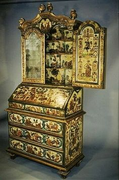 Venetian polychrome painted and parcel gilt lacca povera secretaire; the upper cabinet incorporating inset Venetian mercury plate mirrors, 18th century. A thing of beauty is a joy to behold forever.