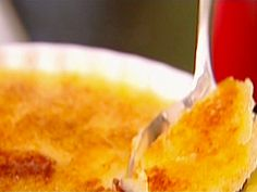 Creme Brulee  This is awesome!  And much easier than I anticipated.  1 extra-large egg  4 extra-large egg yolks  1/2 cup sugar, plus 1 tablespoon for each serving  3 cups heavy cream  1 teaspoon pure vanilla extract  1 tablespoon of your favorite liqueur (ex: Grand Marnier, Disarrono)