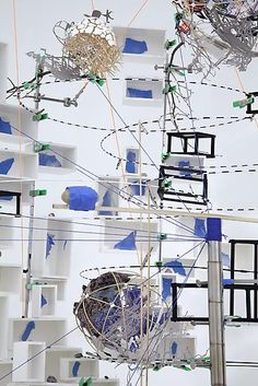 Sarah Sze Disappearing Act 2012 Mixed media, glass, stainless steel, marble, foam core, string, rocks, LED's, egg shells, toothpicks, wood, glicee print on archival paper, bamboo, tennis ball 118 x 156 x 72 inches; 299.7 x 396.2 x 183 cm