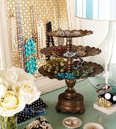 Metal Mesh in Frame for hanging necklaces and vintage dessert pedestal for jewelry storage.