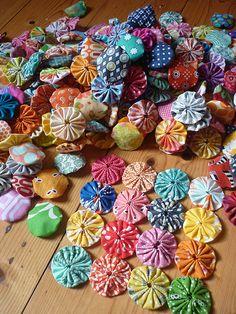 yo-yo quilt in progress: i need a yo-yo maker. these are too fun.