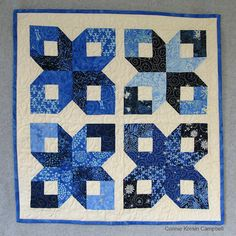Blue Batik Winter Wonderland Wall Hanging posted by Connie Kresin Campbell--I made this to be a table topper but it could also be used as a wall hanging. Notice the variety of blue batiks? I had a little bundle of 3″ x 20″ strips that were included in my Island Batik ambassador box and I challenged myself to use them with the Box Quilt Block tutorial.