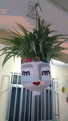 DIY Face Shaped Painted Plastic Bottle Planters - Balcony Decoration Ideas in Every Unique Detail Plastic Bottle Planter, Plastic Jugs, Plastic Bottle Crafts, Recycle Plastic Bottles, Diy Bottle, Face Planters, Flower Planters, Flower Pots, Recycled Garden