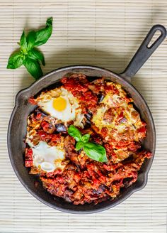 In this traditional Middle Eastern dish, a thick, chunky tomato and eggplant sauce serves as a bed for perfectly-cooked eggs.