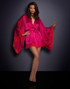 A super silky bedroom look, the Novah is a classic kimono in dazzling fuchsia silk paired with hot red bespoke lace delicately trimming the edges. A simple and elegant piece the Novah kimono drapes around your curves