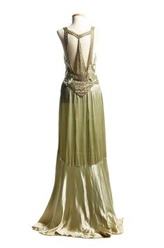 Light green satin evening dress, c. 1932. This stylish gown with a magnificent Art Deco design rhinestone ornamentation on the back