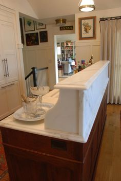 The kitchen island seemed like the perfect spot for marble stone. It is used on the island to create a small visual barrier to hide the dirty dishes piled up around the sink!