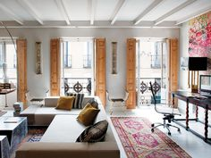 Love the shuttered windows in this Madrid Apartment by Aimee Joaristi.