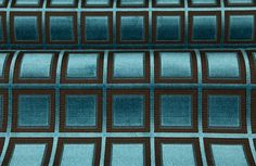 Vinovia Upholstery Fabric in Petrol Blue is a sturdy and modern cut-pile jacquard. The dark brown squares on the blue ground embolden this geometric fabric. The 81% discount will save you $130 per yard of fabric. This low cost fabric is only $29 per yard at FabricSeen's online fabric store.