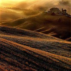 Tuscan hills on a warm summer evening ..