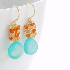 Aqua chalcedony briolettes are topped with clusters of bright tangerine carnelian and golden citrine rondelles in these vibrant and fun gemstone earrings. These remind me of a tropical vacation and make great accessories to brighten up your day.  Total length is approximately 1 7/16 inches (3.7 cm), and the chalcedony briolettes are about 11 mm x 11 mm. See more~ Gold earrings- http://www.etsy.com/shop/aubepine?section_id=6307607 Silver earrings- http:/&#x2F...