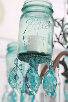 """❤️ How To Make A Farmhouse Mason Jar Chandelier. I colored the chandelier crystals to match the mason jars. There are a couple of ways to achieve the look: I used Pebeo Vitrea """"Turquoise"""" Glass Paints & Pebeo Vitrea Diluant Thinner. OR you can use school glue or Mod Podge & food coloring (I love to do that to change the shade of jars). Lucy of Craftberry Bush has a great TUTORIAL on that at http://www.craftberrybush.com/2011/03/mason-blue-glass-canning-jar-diy.html"""