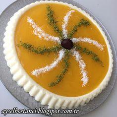 Malzemeler:   1 kg süt   8 yemek kaşığı toz şeker   7 yemek kaşığı irmik   1 paket vanilya   Portakal sosu için:   2 su bardağı portak...