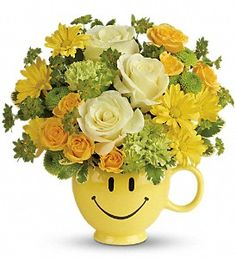 """It's National Smile Week! Make someone special smile today with a bright yellow arrangement created in a 5"""" diameter smiley mug that is perfect for that first cup of coffee or hot cocoa! Prices start at $39.99"""