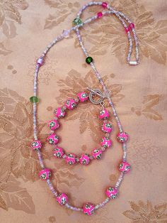 Long necklace and bracelet made of pastel seed beads, faceted glass, lampwork and fimo beads