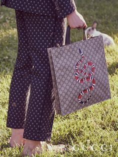 Discover more gifts from the Gucci Garden by Alessandro Michele. Crafted from a new soft material, the GG motif tote with a snake print and the plush Princetown slippers from Gucci Gift.