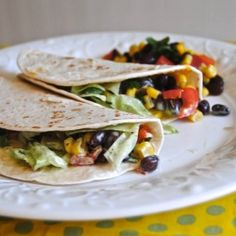 Black bean salsa tacos with a cilantro lime ranch drizzle! The perfect light summer meal!