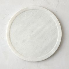 """This simple disc of polished marble makes an elegant charger or display plate on the tabletop.- A terrain exclusive- Marble- Wipe clean with damp cloth- Imported0.75""""H, 11.75"""" diameter"""