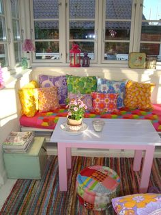 vintage fabric cushions in a rainbow of colours
