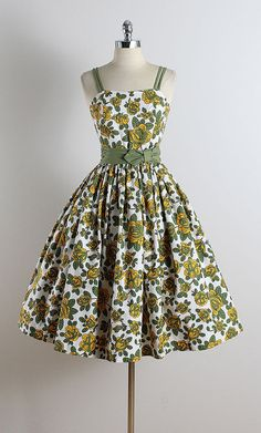 ➳ vintage 1950s dress * heavy floral print cotton * muslin lining hemmed in matching floral fabric * green bow belt * metal back zipper * exceptional quality! condition | excellent fits like xs length 42 bodice 15 bust 34 waist 24 some clothes may be clipped on dress form to show best fit for appropriate size. ➳ shop http://www.etsy.com/shop/millstreetvintage?ref=si_shop ➳ shop policies http://www.etsy.com/shop/millstreetvintage/policy twitter | MillStVintage facebook | millstreetvin...