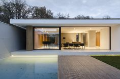 FIRM: LINE architects; PROJECT: Piano House; LOCATION: Chisinau, Moldova. Single-story home set on a pavilion of glass, concrete and wood. The bulk of the home is built around a central courtyard space and makes intentional connections between exterior and interior lines/volumes.