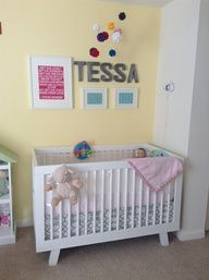 white babyletto hudson 3in1 crib in a yellow nursery
