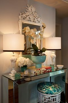 Entry way, hall table with oversized mirror, lamps and decor