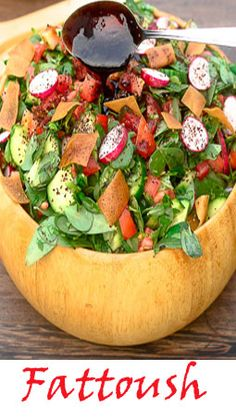 Fattoush! Vibrant, colorful, rich and bursting with flavor! A Middle Eastern /Lebanese bread salad that you will find on the menu of all Lebanese restaurants  around the globe -  and a staple salad in all Lebanese homes.  Fresh vegetables, toasted or fried pita bread, and a bright dressing composed of freshly squeezed lemon juice, sumac pomegranate molasses, and olive oil.