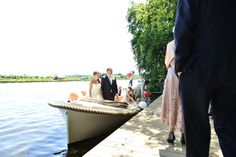 Wedding day in summer by boat Sloep