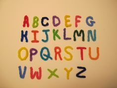 Alphabet Charms. Designed and loomed by elegantfashion360. Click photo for You Tube Tutorials.